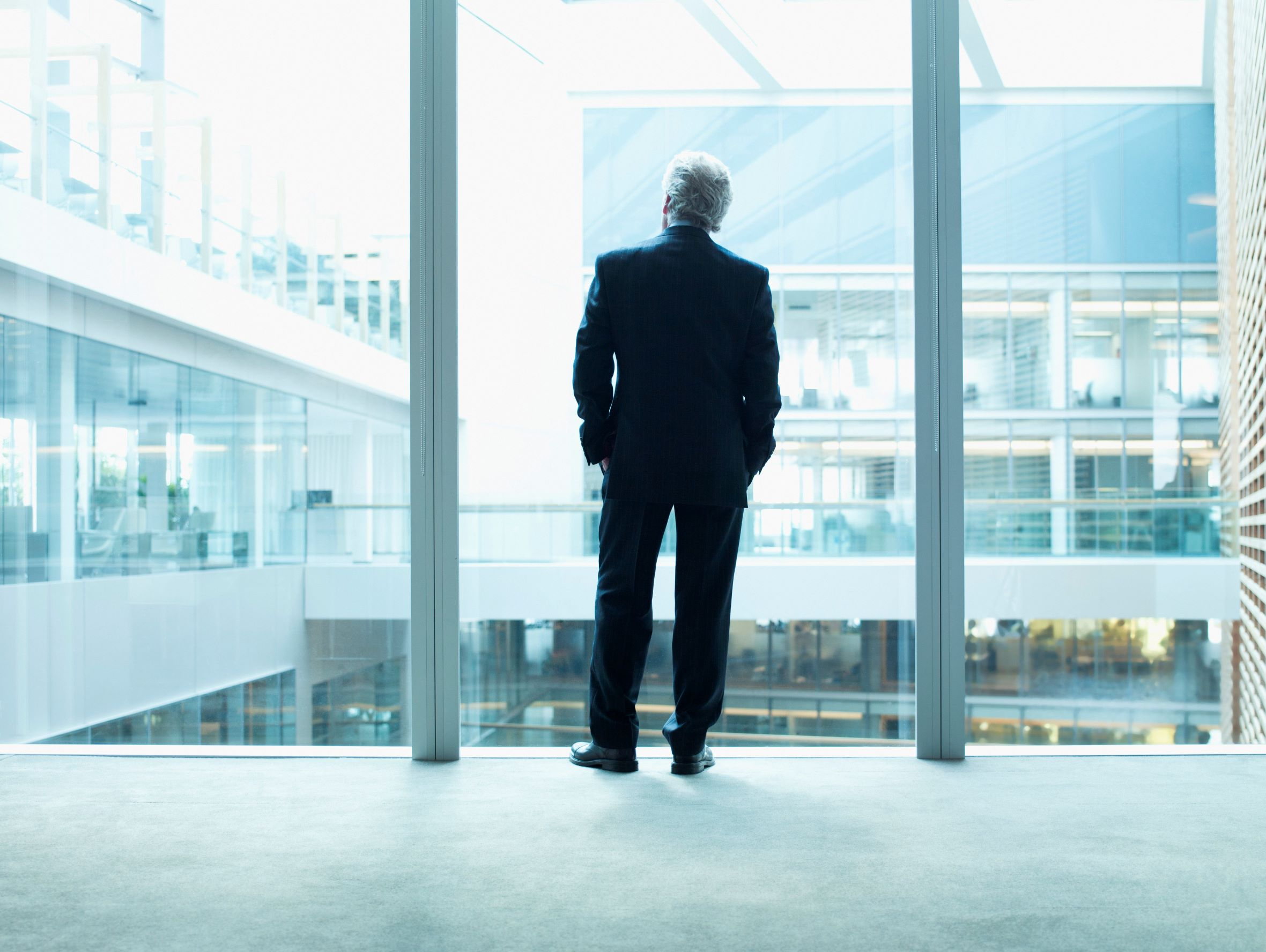 CEO Looking out office window